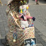 Man posing as a baby in Prague's Old Townhall