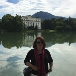 Chris on the other side of the lake of the Hollywood-version of the Von Trapp residence.