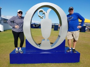 Chris and I, striking a pose with the Open logo on the grounds of Royal Port Rush.